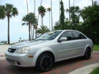 This 2007 Forenza has custom wheels and tires, all the