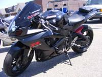 Nice black and maroon GSXR600, aftermarket exhaust,
