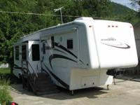 This is a triple axle 36' fifthwheel with 3 slides,