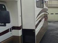 2007 FLEETWOOD 31 FT UNDER 12,000 MILES AND IS IN VERY