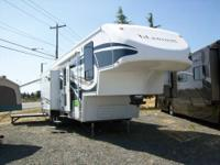 2007 Titanium toy hauler 5th wheel with patio?3