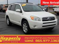 This 2007 Toyota RAV4 Limited in Super White features.
