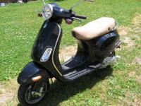 This is a like new 2007 Vespa Piaggio Motor Scooter 150