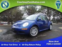 This Beetle is equipped with Heated Leather Seats,