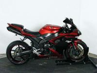 Quite attractive red Yamaha R1. New tires, aftermarket