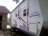This 30fl. travel trailor boost 350 sq. ft. of living