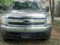 2007 Chevy Silverado LS Extended Cab 4x4 truck with low
