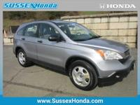 This outstanding example of a 2007 Honda CR-V LX is