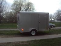 2008 10 ft by 6 ft enclosed trailer with ramp and side