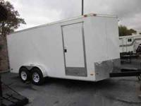 "White trailer, 6'-8"" tall, electric brakes, side door,"