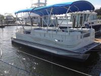 With a 90 hp Mercury four-stroke on the transom, the