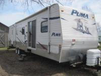 39 foot Puma by Palomino. Park model camper with awning