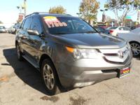 This STERLING GRAY METALLIC MDX HAS A CLEAN CARFAX AND