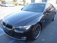 This BMW 328i Coupe is Black On Black with Black OEM