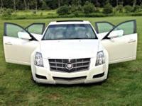 Pearl white Cadillac CTS 2008. Please significant