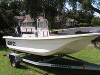This is a Clean 16 JVX by Carolina Skiff center console