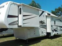 "3 slide-outs. This 5th wheel has a 42"" flat screen TV,"