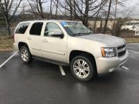 THIS IS A 1 OWNER FULLY LOADED TAHOE WITH MOONROOF AND