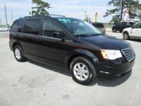 This 2008 Chrysler Town & Country Touring has it all.