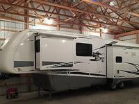 : This is a 2008 Newmar Cypress 5th wheel camper with