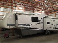 This is a 2008 Newmar Cypress 5th wheel camper with