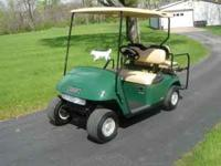 Cart has a top, hubcaps, new(( headlights, tailights,