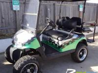 Custom-made Painted 2008 EZGO RXV Gas.  We completely