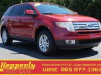This 2008 Ford Edge SEL in Redfire Metallic features.