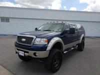 **KEYLESS ENTRY**, **LEATHER INTERIOR**, **35 TIRES AND