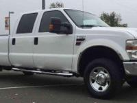 THIS LONG BED POWER STROKE CREW CAB IS A 2 OWNER NO