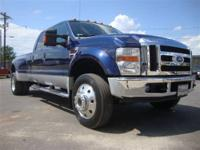 This 2008 Ford Super Duty F-450 4x4 Truck features a