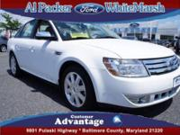 You will love this White Ford Taurus! This vehicle is