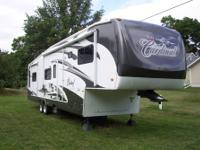 2008 Forest River Cardinal 4 slides with covers,