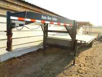 Around 27 ft long gooseneck trailer with heavy duty