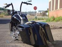 Offering a 2008 Harley Davidson Road King FLHP Custom.