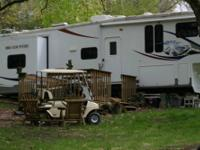 33ft fifth wheel trailer. 3 slides w/ awnings. It has