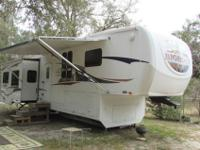 Spick-and-span four slide 5th wheel with Rear Living,