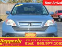 This 2008 Honda CR-V EX-L in Glacier Blue Metallic