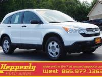 This 2008 Honda CR-V LX in Taffeta White features.