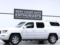 Exterior Color: White Transmission: Automatic Engine: