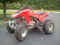 This 2008 Honda trx250ex has been lady driven,