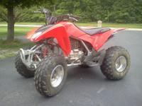 This 2008 Honda trx250ex has been lady driven,