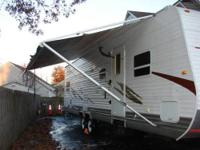 2008 Pine Creek travel trailer, by Hyline 31 ft, one 12