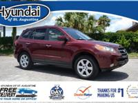 This Santa Fe features: AWD, Tow Hitch, Beige w/Leather