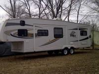 Model #F31.5 FBHS 2008 fifth wheel camper. Still in