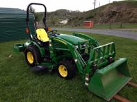 Selling a John Deere 2320, 4x4 with turf tires, two