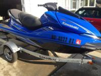 This is a 2008 Kawasaki Ultra 250x including trailer.