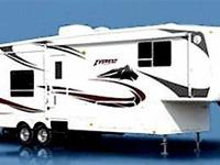 Keystone Everest 5th wheel with 4 bump-outs. Rear