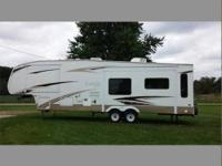 This is a 34ft Fifth Wheel with rear living room and 2