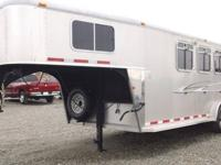 This is a 2008 Logan Horse Trailer. It is a tandem